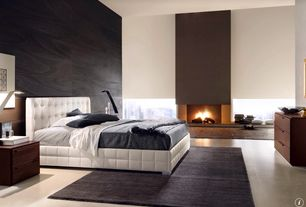 Contemporary Master Bedroom with Fireplace, White leather platform bed, Concrete floors, Standard height, insert fireplace