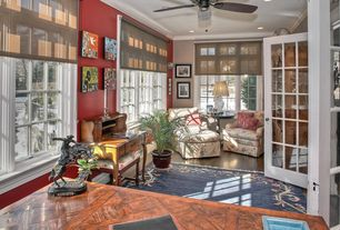 Eclectic Living Room with Ceiling fan, Crown molding, Laminate floors, French doors
