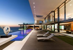 Modern Patio with Infinity pool, exterior stone floors, Covered deck, Pathway