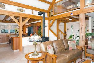 Craftsman Great Room with High ceiling, Built-in bookshelf, limestone tile floors, Pendant light, Exposed beam, Loft, Columns
