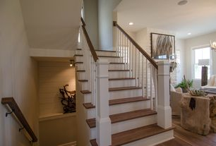 Cottage Staircase with Built-in bookshelf, Hardwood floors