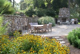 Traditional Patio with Fence, exterior stone floors, Raised beds, Pathway, Outdoor kitchen