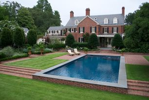 Traditional Swimming Pool with Trellis, Fence, Pathway, Raised beds, exterior brick floors, Pool with hot tub