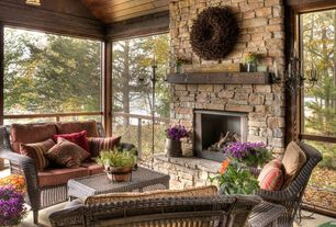 Rustic Porch with stone fireplace, Wrap around porch, Wicker furniture