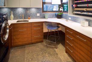 Contemporary Home Office with Caesarstone 6141 ocean foam, Knoll bertoia barstool, Built-in bookshelf, sandstone floors