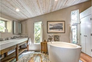 "Eclectic Master Bathroom with Stone Tile, High ceiling, Barclay t48fc 48"" fire clay trough, Flush, European Cabinets"