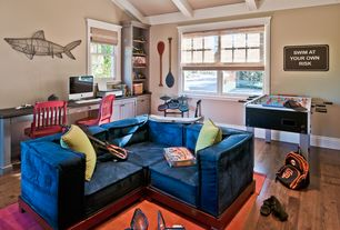 Traditional Playroom with double-hung window, Exposed beam, Standard height, Built-in bookshelf, Hardwood floors