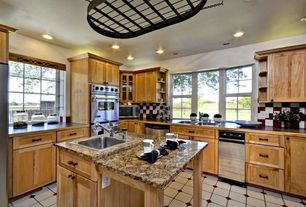 Craftsman Kitchen with Casement, Flat panel cabinets, Large Ceramic Tile, Soapstone counters, double wall oven, Flush