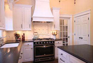 Traditional Kitchen with Kitchen island, French doors, Subway Tile, Raised panel, Inset cabinets, High ceiling, L-shaped