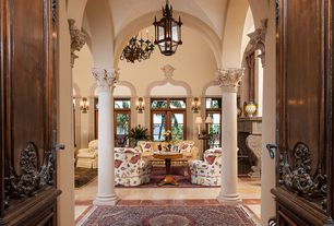 Traditional Entryway with Concrete tile , six panel door, Cathedral ceiling, flush light, Casement, Columns