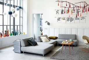 Contemporary Living Room with Concrete floors, Wainscotting, High ceiling, Chair rail, Eames molded plastic rocker (rar)