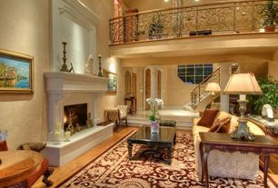 Traditional Living Room with Sunken living room, can lights, High ceiling, Louvered door, Fireplace, Casement