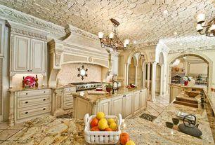 Traditional Kitchen with Undermount sink, Columns, stone tile floors, limestone tile floors, Multiple Sinks, Custom hood