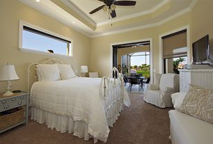Traditional Master Bedroom with Standard height, Carpet, picture window, Ceiling fan, can lights, Crown molding
