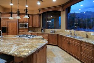 Craftsman Kitchen with picture window, Complex granite counters, can lights, Built In Panel Ready Refrigerator, Pendant light