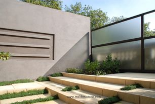 Contemporary Landscape/Yard with Raised beds, exterior tile floors, Fence, Harrell Custom Glass Fencing