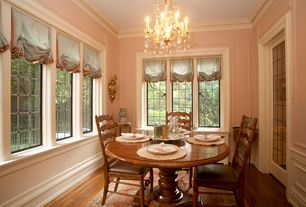 Traditional Dining Room with Standard height, Chandelier, specialty window, Hardwood floors, Crown molding