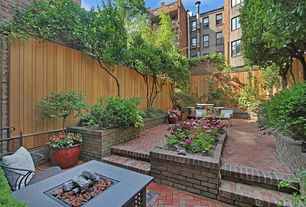 Traditional Patio with Raised beds, exterior brick floors, Fire pit, Fence, Pathway