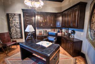 Traditional Home Office with Chandelier, Built-in bookshelf, Standard height, Hardwood floors, six panel door