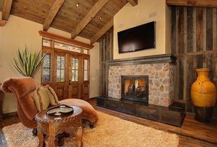 Eclectic Living Room with French doors, Transom window, stone fireplace, Hardwood floors, Exposed beam