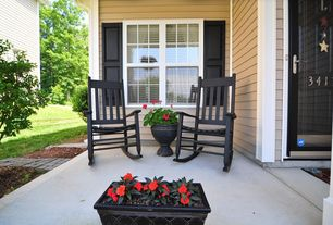 Traditional Porch with exterior tile floors, wood siding, Exterior window shutters, Bloem grecian round urn - wayfair