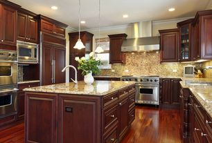 Craftsman Kitchen with Complex granite counters, Complex Granite, full backsplash, double oven range, Casement, Glass panel