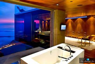 Contemporary Master Bathroom with Flokati white shag rug, European Cabinets, Modern soaking bathtub, Bathtub, picture window
