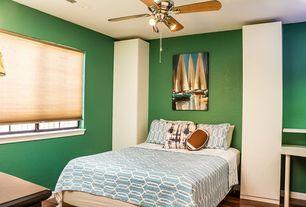 Eclectic Guest Bedroom with Hardwood floors, Ceiling fan
