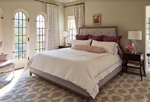 Traditional Master Bedroom with Arched window, Ikat ogee curtain, ivory/platinum, Lyric tufted king bed, Glass urn table lamp