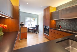 Contemporary Kitchen with Breakfast nook, U-shaped, double-hung window, Built In Refrigerator, Standard height, Glass panel