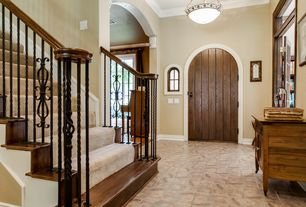 Craftsman Entryway with Standard height, flush light, six panel door, Casement, Crown molding, Transom window, Concrete tile