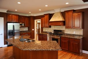 Contemporary Kitchen with Simple granite counters, Kitchen island, L-shaped, Custom hood, Raised panel, Crown molding
