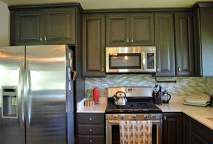 Contemporary Kitchen with Raised panel, Simple granite counters, L-shaped, Undermount sink, Ceramic Tile, Flush