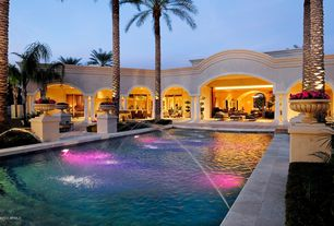 Tropical Swimming Pool with Lap pool, exterior stone floors, Fountain