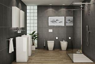 Contemporary Master Bathroom with Daltile Veranda Solids Gunmetal Porcelain Field Tile, Handheld showerhead, Hardwood floors