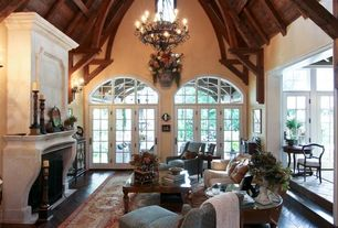 Traditional Great Room with High ceiling, Wall sconce, Hardwood floors, Sunken living room, Paint, French doors, Fireplace