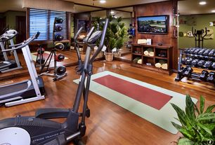 Traditional Home Gym with mirrored walls, Built-in bookshelf, Wood baseboard, Crown molding, Hardwood floors, Ceiling fan
