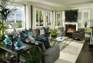 Traditional Living Room with stone fireplace, Pottery barn cameron sectional in suede - metal gray, Crown molding, Shutter