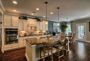 Traditional Kitchen with Kitchen island, Breakfast bar, Limestone Tile, double-hung window, double wall oven, Multiple Sinks