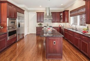 Traditional Kitchen with Flush, specialty door, Glass panel, Crown molding, U-shaped, Complex granite counters, Raised panel