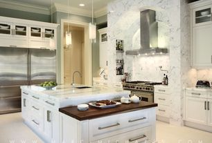 Contemporary Kitchen with L-shaped, Wall Hood, can lights, Kitchen island, Built In Refrigerator, Standard height