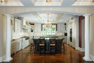 Traditional Kitchen with Chandelier, Tuscan column, Limestone Tile, Simple granite counters, Kitchen island, Undermount sink