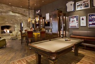 Rustic Game Room with Built-in bookshelf, Hardwood floors