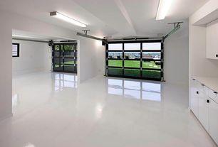 Modern Garage with Standard height, flush light, Exposed beam, Concrete floors, specialty door, Built-in bookshelf