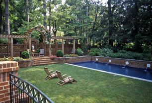 Traditional Swimming Pool with Fountain, Fence, exterior brick floors, Trellis, Raised beds, Lap pool, Arbor