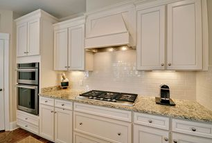 Traditional Kitchen with Subway Tile, full backsplash, double wall oven, One-wall, Hardwood floors, Inset cabinets