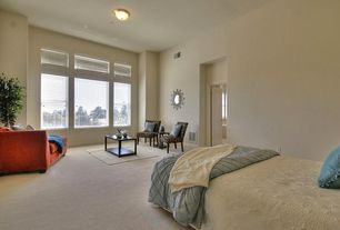 Contemporary Master Bedroom with specialty door, picture window, double-hung window, flush light, can lights, Carpet