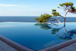 Contemporary Swimming Pool with Infinity pool, exterior stone floors