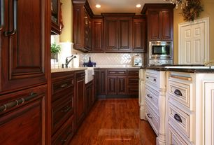 "Traditional Kitchen with Daltile - natural hues ceramic floor and wall tile carnation 4"" x 8"", Chandelier, Raised panel"