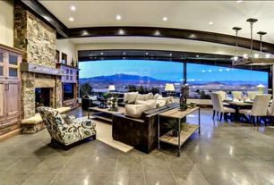 Contemporary Great Room with Fireplace, Standard height, Exposed beam, Chandelier, stone tile floors, stone fireplace